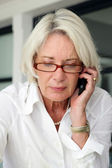 Mature businesswoman making telephone call — Stock Photo