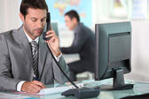 Executive on the phone in ffice — Stock Photo