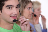 Young with telephone headsets — Stock Photo