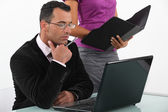 A boss and his secretary at work. — Stock Photo