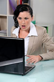 Brunette having technical problems — Stock Photo