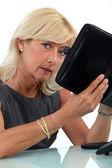 Senior businesswoman with personal diary — Stock Photo