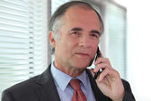 Senior businessman negotiating over the phone — Stock Photo