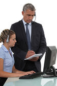 Call-center employee with boss — Stock Photo