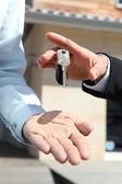 Agent handing over house keys — Stock Photo