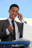 Delighted businessman on the phone — 图库照片