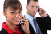 Businesspeople using cellphones — Stock Photo