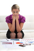 Businesswoman examining graphic charts — Stock Photo