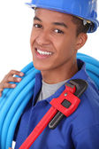 Portrait of a young apprentice with wrench — Stock Photo