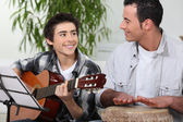 Father and son playing music together — Stock Photo