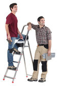 Two tilers pausing to look at something — Stock Photo