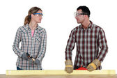 Carpenters making eye contact — Stock Photo