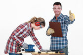 Couple working at a workbench — Stock Photo