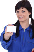 Craftswoman showing card — Stock Photo