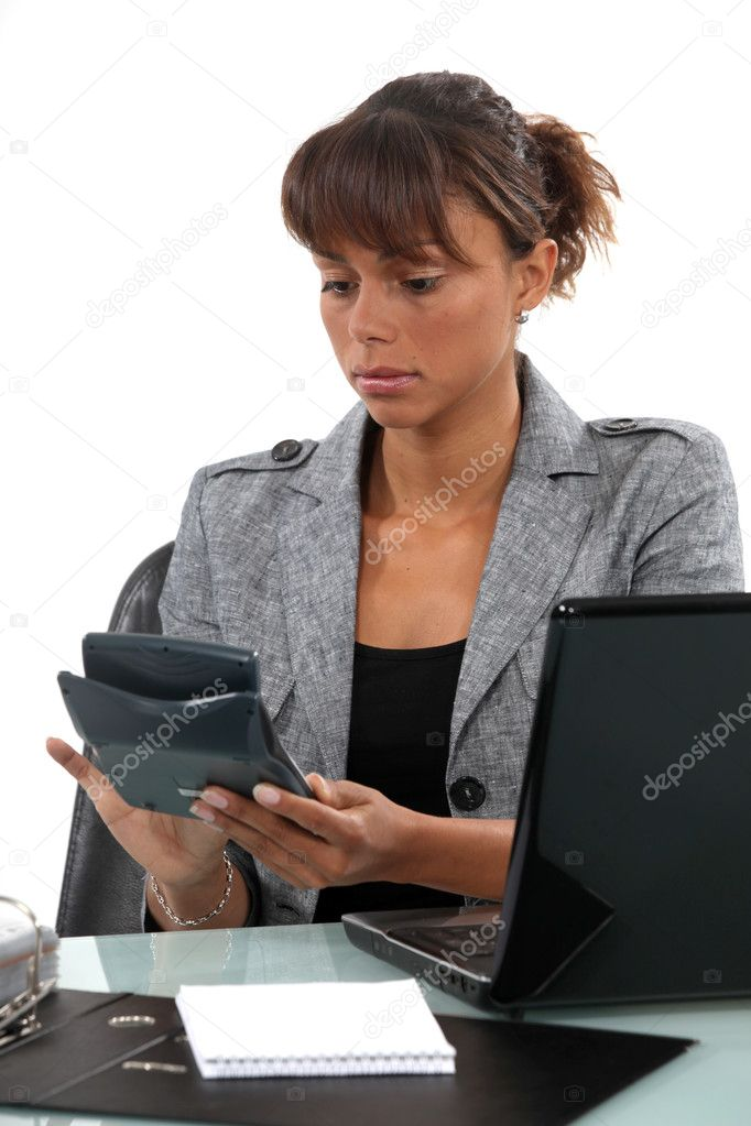 Businesswoman with a calculator — Stock Photo #9704609