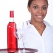 Waitress with a bottle of rose wine — Stock Photo
