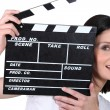 Young woman with a film clapperboard — Stock Photo #9722445