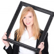 Young woman holding a black frame — Stock fotografie