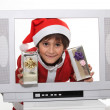 Stock Photo: Little boy in Christmas dress behind TV screen