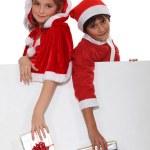Children dressed as Santa Claus — Stock Photo