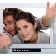 Royalty-Free Stock Photo: Couple popping out the TV.