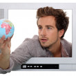 Man looking at globe — Stock Photo #9724466