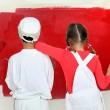 Children painting a wall — Stock Photo