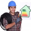 Stock Photo: Electriciholding energy consumption label