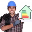 Stock Photo: Electriciwith energy rating card