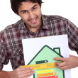 Man holding abcd image house — Stock Photo