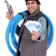 Plumber holding wedge of cash — Stock fotografie #9725669