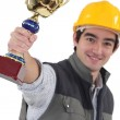 Laborer showing a cup — Stock Photo