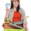 Woman making money by recycling - Stock Photo