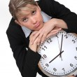 Stock Photo: Businesswoman with a clock