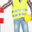 Road worker with sign - Stock Photo