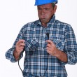 Untrained electrician getting a shock - Stock Photo