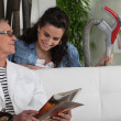 Cleaning lady with senior woman — Stock Photo