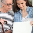 Stock Photo: Help seniors with Internet