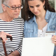 Help seniors with Internet — Stock Photo #9727841