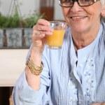 Senior woman having breakfast — Stock Photo