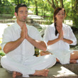 Couple doing relaxation exercises - Stock Photo