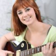 Foto Stock: Woman with Guitar
