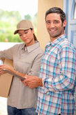 Man collecting package at home — Stock Photo