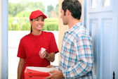 Woman delivering pizza — Stock Photo