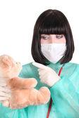 Doctor scolding a teddy bear — Stock Photo