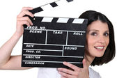 Young woman with a film clapperboard — Stock Photo