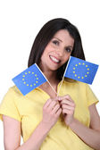 Woman with paper flags — Stock Photo