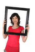 Woman holding a picture frame — Stock Photo