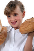 Girl with loaves of bread — Stock Photo