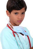 Young boy pretending to be a doctor — Stockfoto